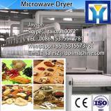 Continuous tunnel type microwave dryer for wood products