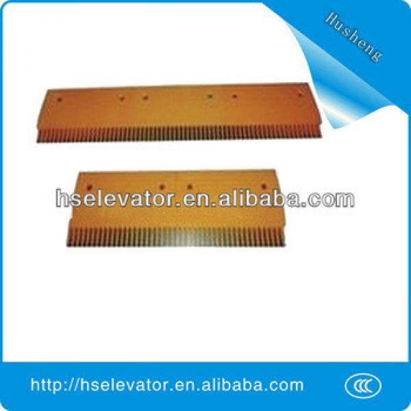 escalator comb floor plate, escalator yellow strip, escalator comb plate #1 image