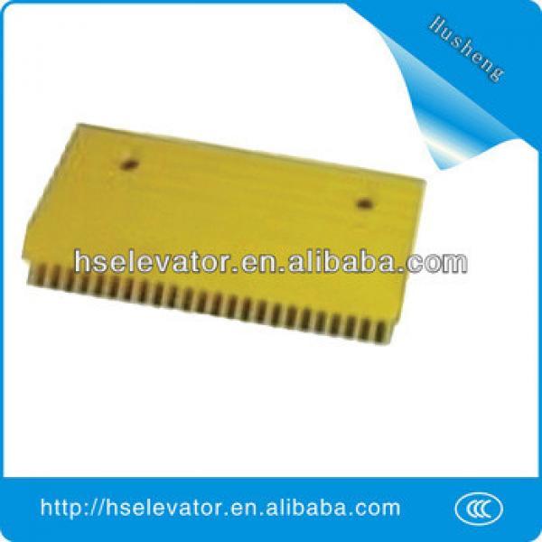 escalator yellow strip, elevator yellow border, escalator comb plate #1 image